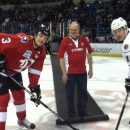 Dropping the first puck.